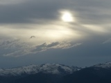 Sun, Clouds and Mountain Range